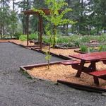 Landscape construction- retaining wall, parking area, simple arbor with planter borders