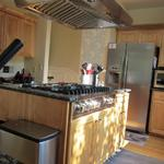 Woodinville: Viking Gas Range installed in exisitng kitchen island with new Wolf hood